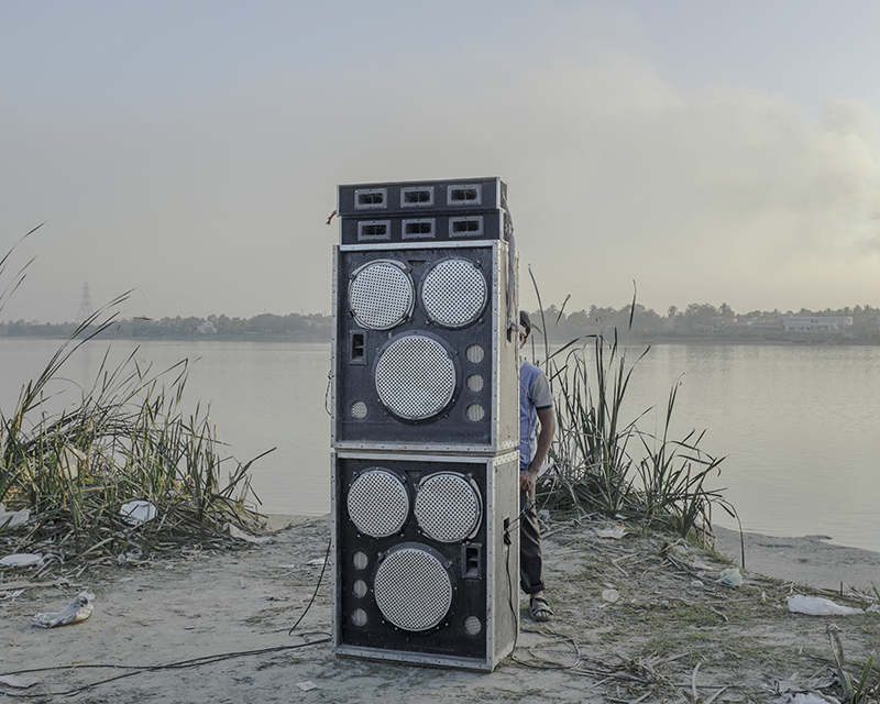 India, West Bengal, Kolaghat, January 2014. Most of the loudspeakers blare popular music from recent Bengali and Hindi films. Some groups transport an array of loudspeakers on trucks specially to make the most of their day-out.