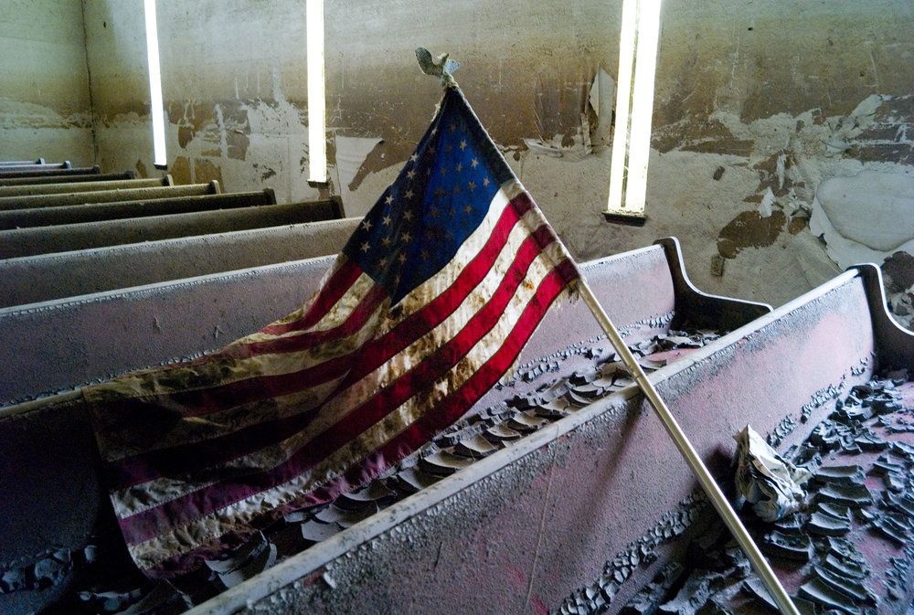 New Orleans, LA. The Lower 9th Ward. A Katrina mud covered flag is strewn in a church in the lower 9th ward. No one has begun to clean it up or renovate it. 2007.  New Orleans, LA 2007. A church in the 9th ward was destroyed by hurricane Katrina and has not been touched two years later.