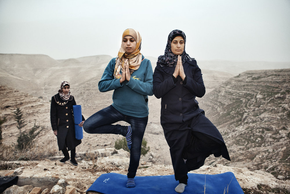 Occupied Palestinian Territories, West Bank, Za'tara, 06 January 2013  Hayat (left) teaches yoga to the residents of her village, Zataara,  on the outskirts of Bethlehem in the West Bank. The women are increasing in number each week.