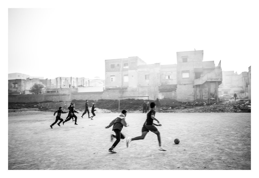 Tunisia, Tunis, Douar Hicher, 21 December 2015Kids playing soccer in Douar Hicher, an impoverished neighborhood in Tunis outskirts. Most of the young combatients joining ISIS from this country came from this area. After the Jasmine Revolution of 2011 in Tunisia, young people began disappearing from neighborhoods like Douar Hicher, a poor suburb of Tunis. It is estimated that between six and seven thousand Tunisians have gone to Syria and Iraq to wage jihad.Sebastian Liste / NOOR