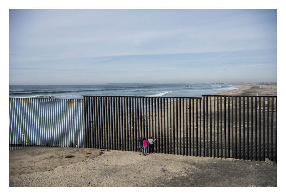 Mexico, Baja California, Tijuana Beach, 01 February 2017A Mexican family looking throught the US-Mexican border fence.Sebastian Liste / NOOR
