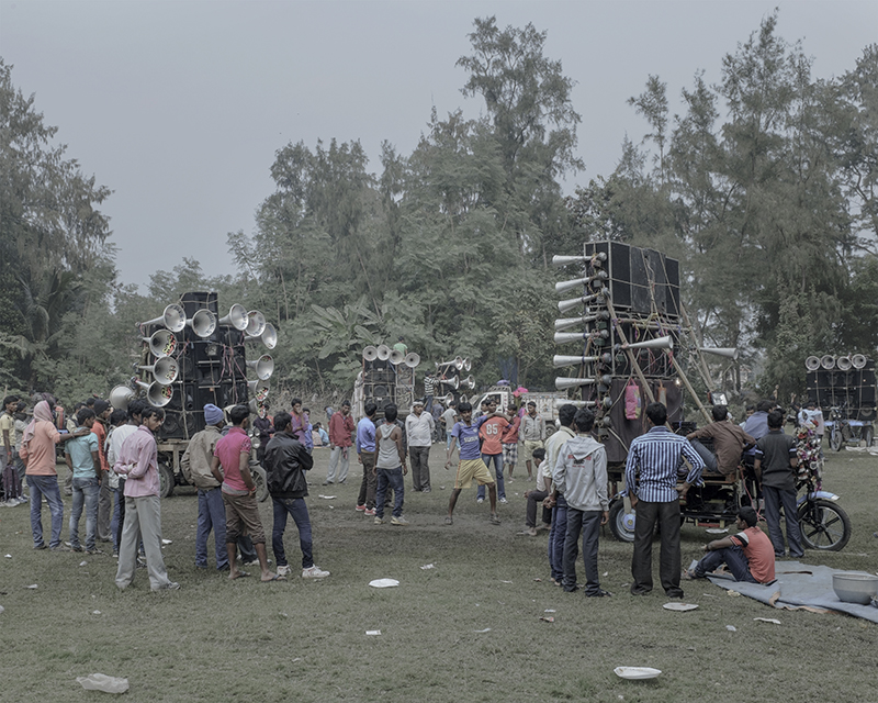 India, Bakkhali, December 2015. Extravagant loudspeakers come with nearly every picnic group. Transported in their own hand drawn carts or mini-vans, separate generators are also brought along to pump up the electricity in the great outdoors.