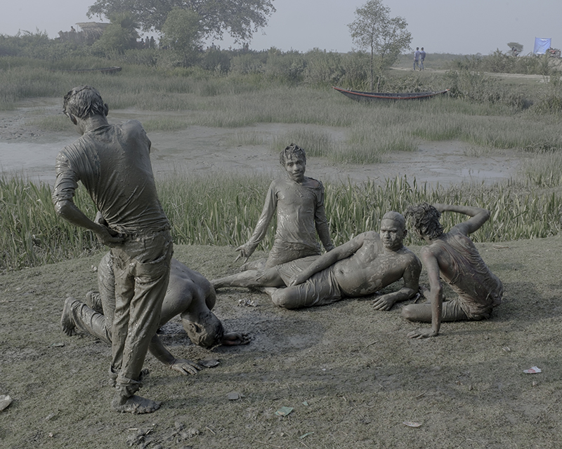 India, Kulpi, December 2016. Inebriated mud-bathing by the Ganges river on New Years Day.