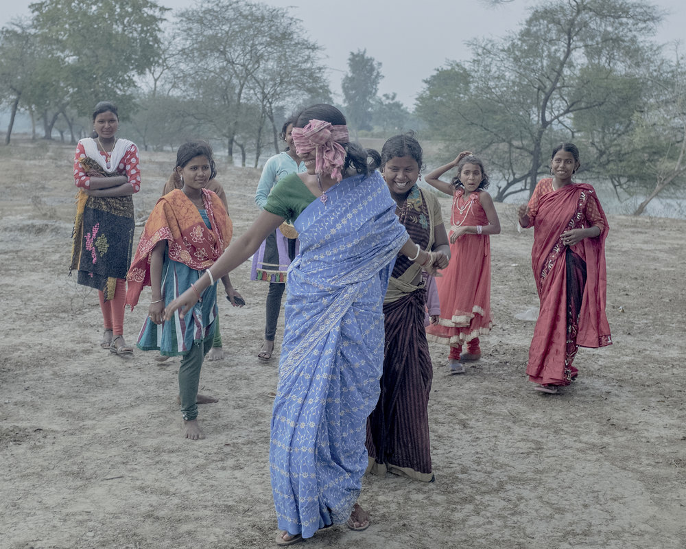 India, West Bengal, Sunderbans, January 2015. A game of Catch played by friends and family.