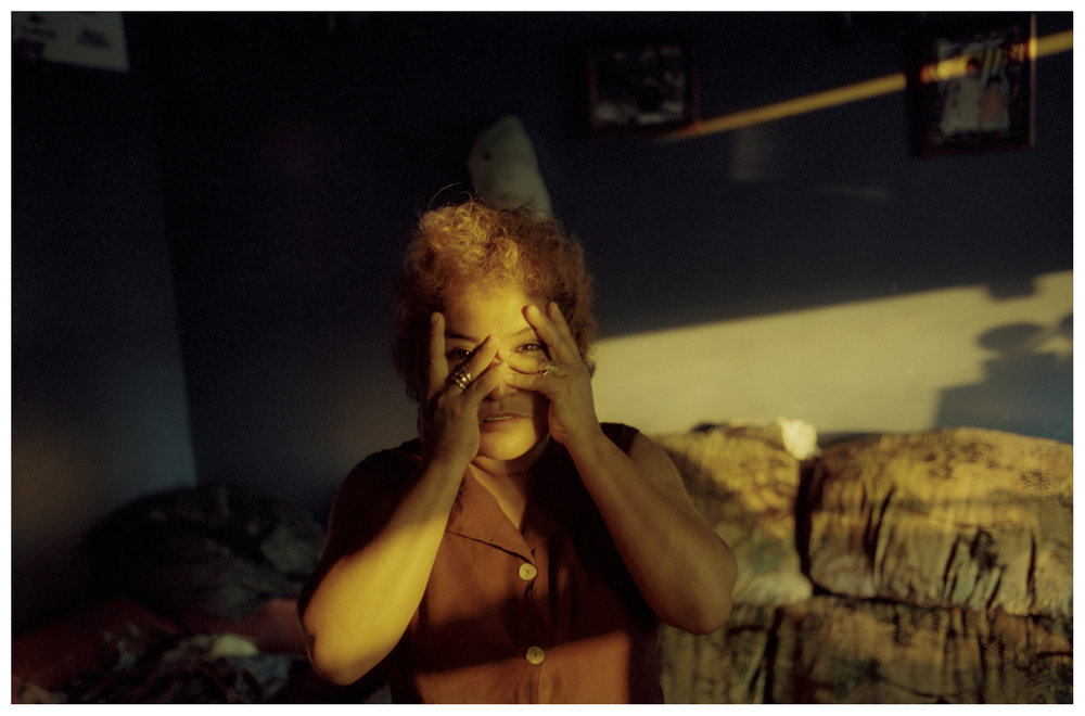 Guadalupe Guzman at her Back of the Yards home. Lupe has been selling elotes on the street for more than 15 years. This photograph was taken circa 2002.
