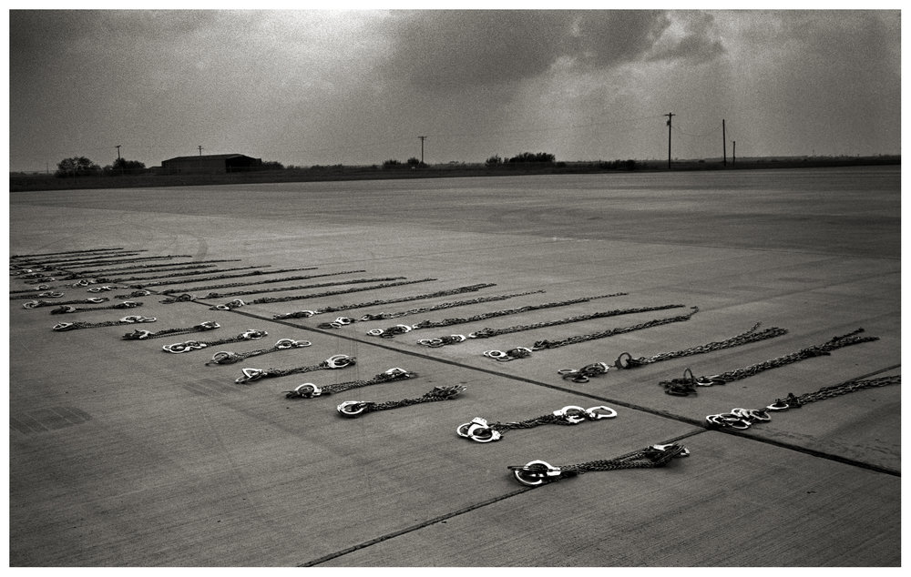 Handcuffs lie on the ground before being put away after shackling a group of undocumented immigrants who were being transported from Pennsylvania to the border crossing at Hidalgo. All the men had spent time in county jail in Pennsylvania and were sent back acrosss the border to Reynosa, Tamaulipas, Mexico.