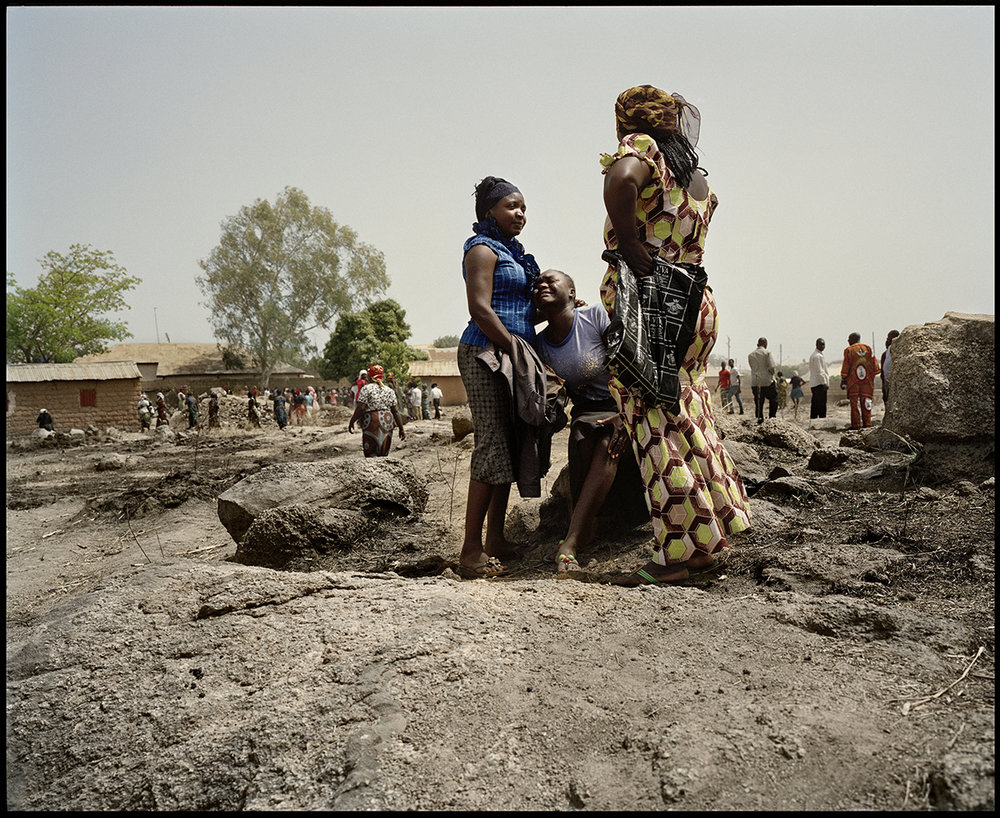 Nigeria, Jos South, March 2012, Berom girls cry at the funeral of Sunday Pam. Sunday, 27yo, has been killed in the suicide attack targeting the catholic Church Saint Finbar, in Rayfield, Jos South. Boko Haram claim to be the perpetrators of the suicide attack.