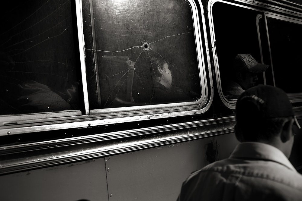 Guatemala, Guatemala City, February 2008, There is so much violence and shooting in the city that the bus companies rarely try to fix the windows that get shot out.