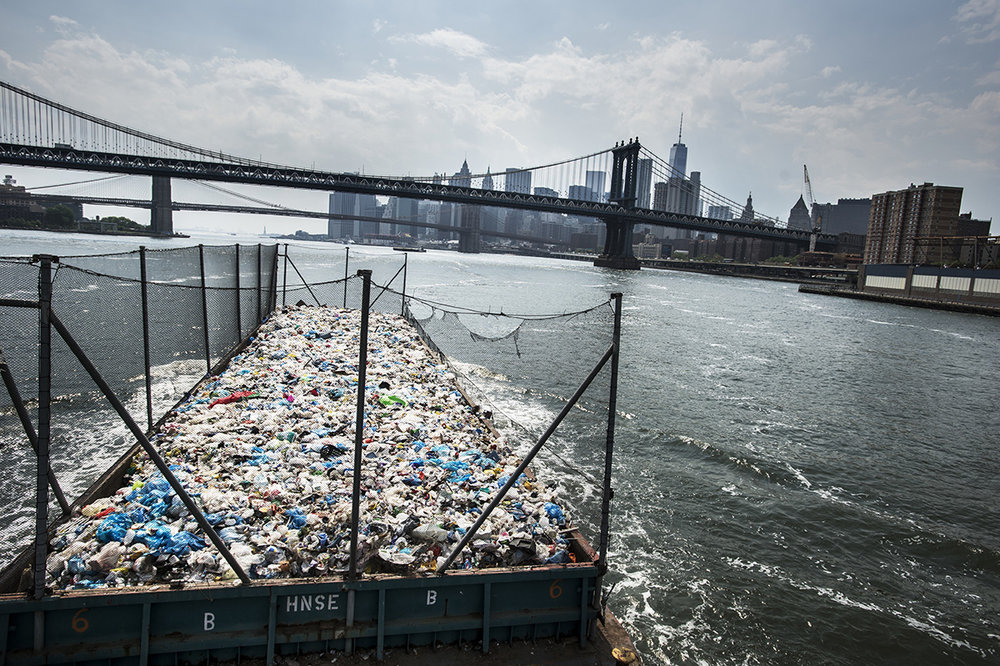 USA, New York, New York City, 26 May 2016A barge transports two days of plastic waste from the Bronx and Queens to Sims Municipal Recycling in Brooklyn. Sims is one of the very few recycling companies in NYC.Kadir van Lohuizen / NOOR