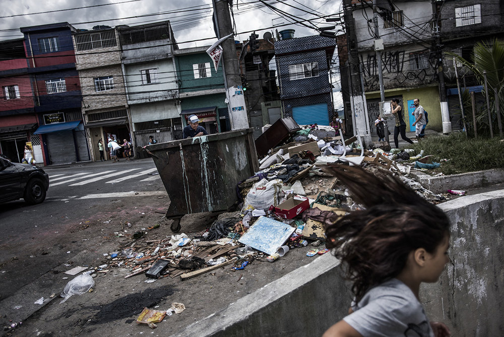 Brazil, São Paulo, December 2016, Waste on the streets at containers, which are infrequently emptied.