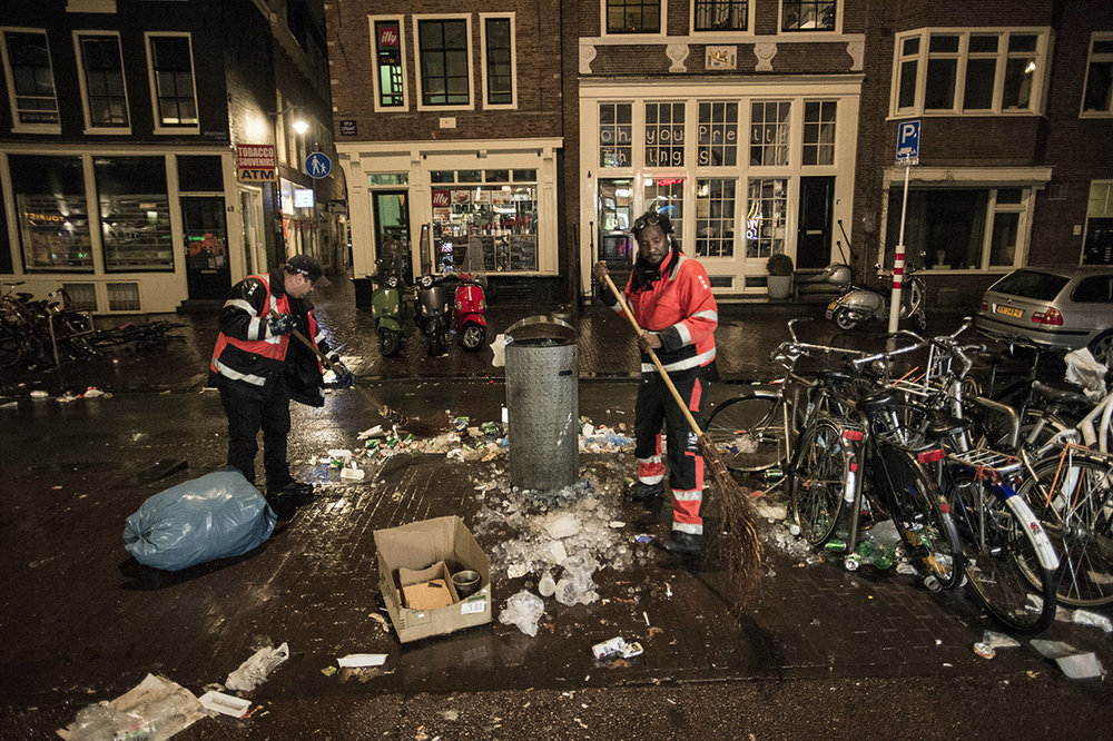 Netherlands, Amsterdam, April 2017, Crews from the city of Amsterdam cleaning the streets at night after Kings day.