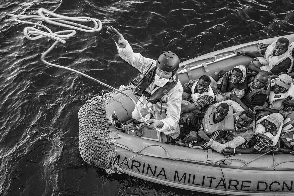 Mediterranean Sea, 21 August 2015, A rigid-hulled inflatable boat (or RIB) of the Italian Navy approaches the Bourbon Argos to transfer rescued migrants onto the MSF ship.