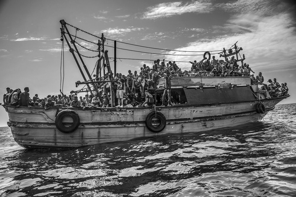 Mediterranean Sea, 26 August 2015, A wooden fishing vessel sailing from Libya and carrying more than 500 migrants is approached by the MSF Bourbon Argos search and rescue ship.