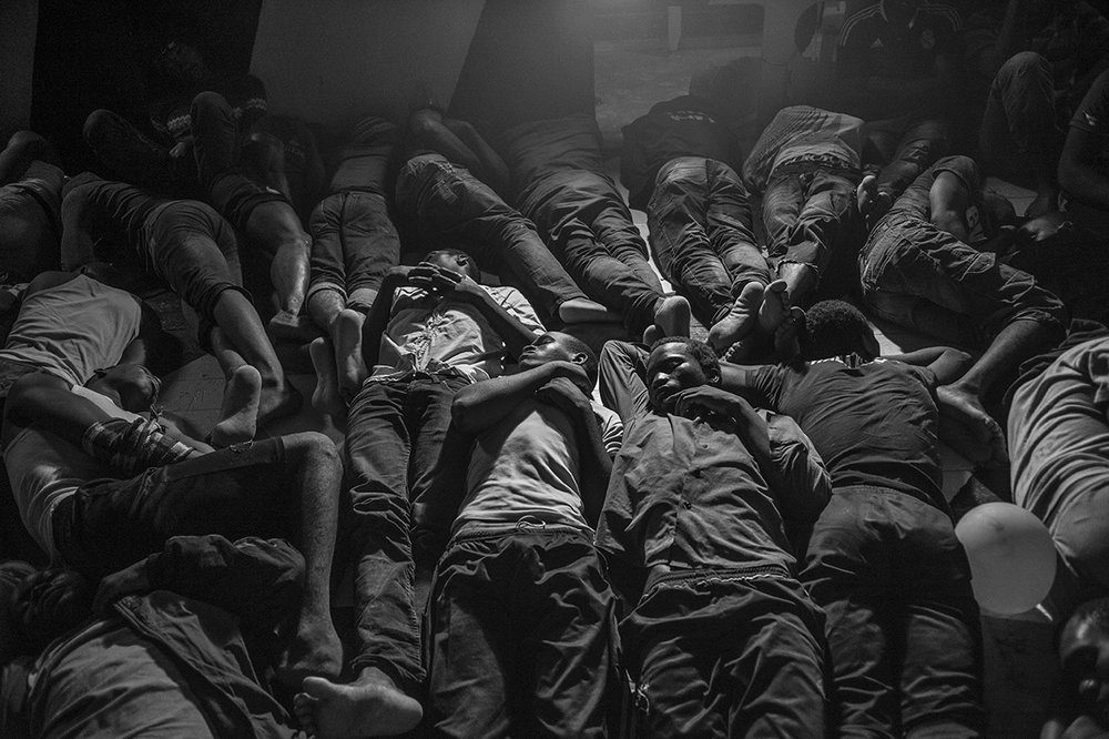 Mediterranean Sea, 21 August 2015, Rescued migrants spend the night on the deck of the MSF Bourbon Argos search and rescue ship.