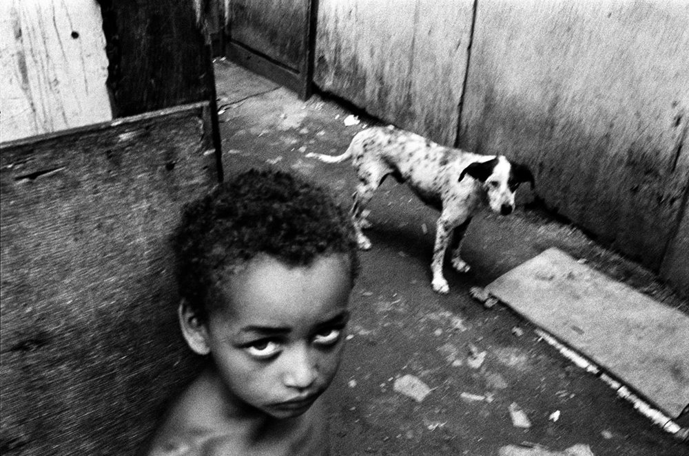 "Brazil, 1994, Every six hours a child dies on the streets of Brazil. The ""meninho de rua"" (child of the street) is the symbol of Brazil's degradation."