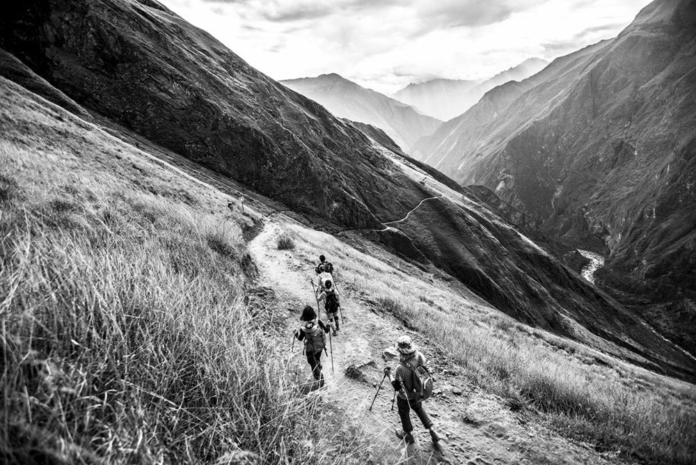 Peru, Cachora, August 2016, People trekking the route from Cachora to Chiquisca Camp (1,800m/5,900 ft) near the Apurimac River.