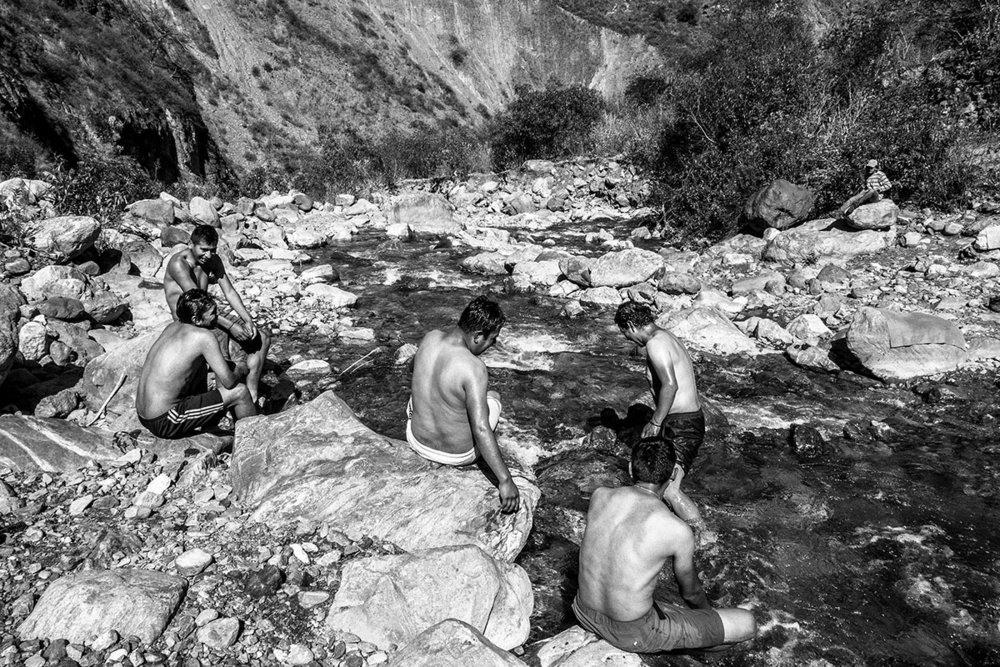 Peru, Andes, August 2016, Porters and cooks having bath at Quebrada Yurahayo, a stop in the route from Choquequirao to Maizal Camp.