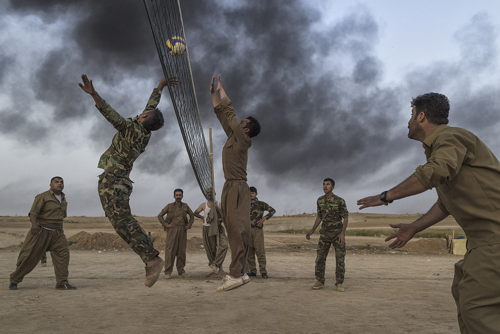 Iraqi Kurdistan, Kirkuk, April 2015, Kurdish troops called Peshmerga play volleyball behind the front lines. When ISIS fighters, whose ranks are believed to include former Iraqi Army officers, began capturing Iraqi towns in 2014, the peshmerga proved one of the only forces able to stop them.