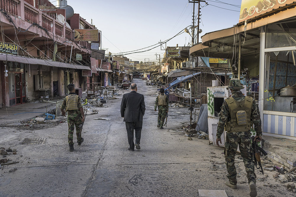 Iraqi Kurdistan, Jalawia, September 2015, Acting Mayor of Jalawla, a town at the tip of Diyala province, stands in the ruins of his town. His family home was destroyed by ISIS and much of the town suffers the damage of the battle to push ISIS from Jalawla in late 2014. Despite being free of ISIS, the residents of Jalawla aren't allowed back and the town is still strewn with IEDs.