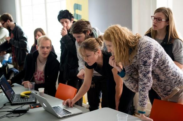 Andrea Bruce works on edits with L-R: Matjaž Rušt, Matic Zorman (Slovenia), Milovan Milenković, Mina Delić and Oksana Toskic (Serbia). Photo: Marko Rupena / Kamerades