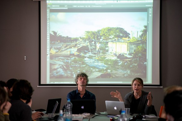 Kadir van Lohuizen and participants listen as Andrea Bruce talks about a recent assignment shot for The New York Times.