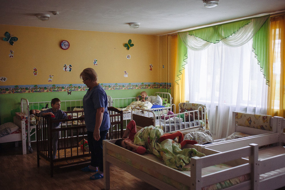 Nurse communicates with one of the children that lives  in the orphanage for disabled children with special psychophysical development. October 10, 2016, Minsk, Belarus.