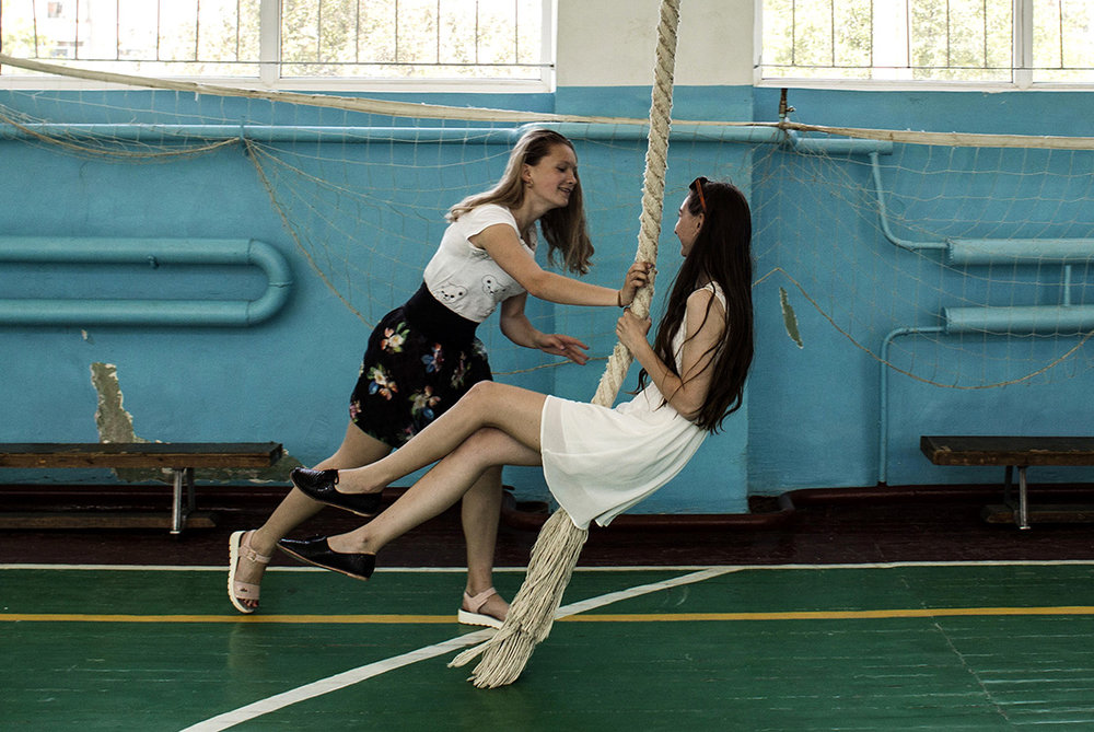 Tatiana Kolesnikova and Oleksandra Kovalyova play on a rope in a school gym in Shchastya, Luhansk area, Ukraine. 