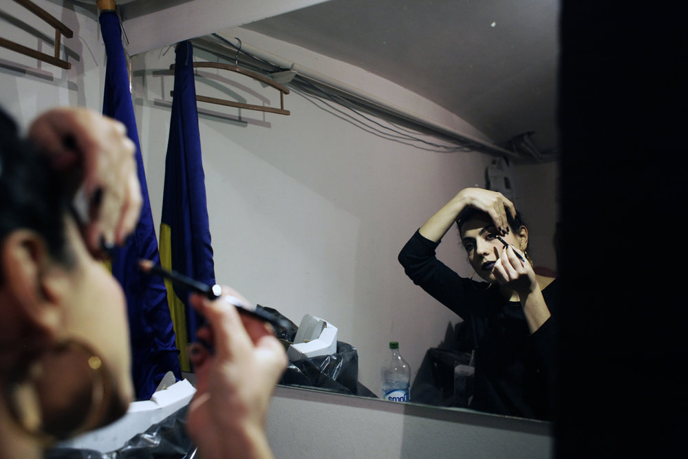Mihaela Drăgan applies make-up before a show at Green Hours Jazz Caffee in Bucharest, Romania, on February 5th, 2016.