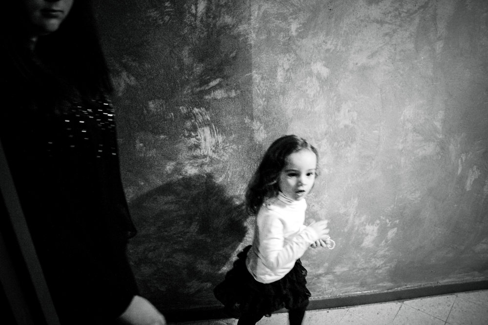 """France, Marseille, 08 December 2012A little girl runs to see the bride's """"Tasdira"""" with new dresses. The bride will wear several looks during the party: the higher the social level of the family, the more the dresses the bride will have to wear.Claudia Cuomo / NOOR"""