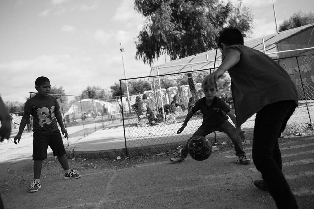 Syrian refugees play football inside Kara Tepe camp, Lesbos, Greece. The camp is for Syrian refugees.