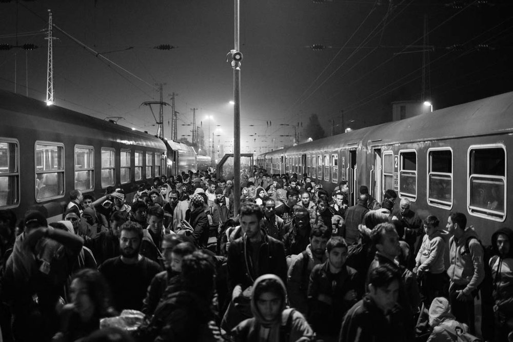 Refugees arrive via a night train that transported them into Austria in the early hours of the morning. Hegeyeshalom crossing, Austria.
