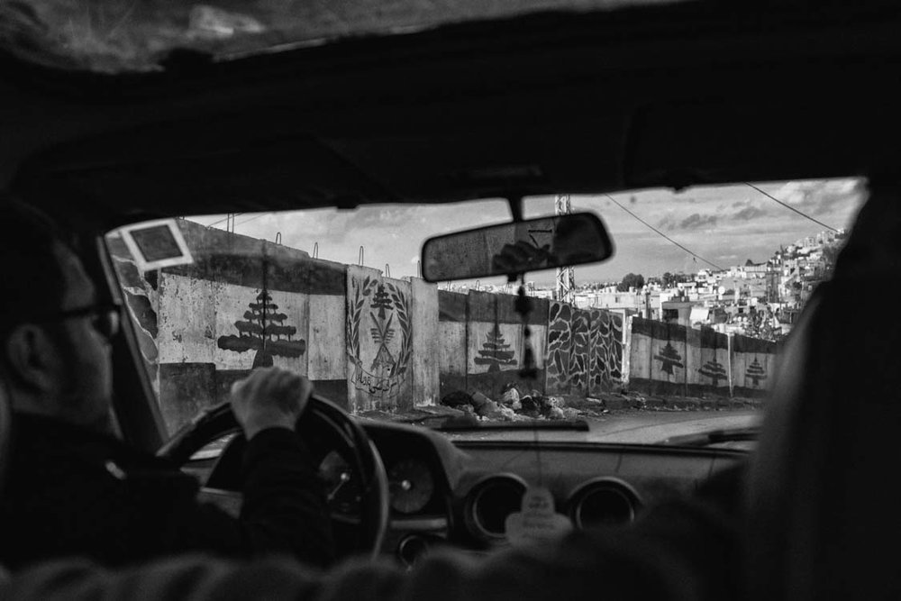 Driving around the security wall of Ain el Hilweh, refugee camp in Lebanon.