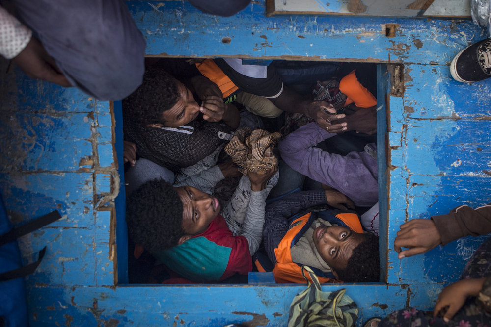 Inside the hold of a large wooden boat where over 500 people were attempting to cross the mediterranean sea � Mathieu Willcocks/MOAS.eu 2016, all rights reserved.