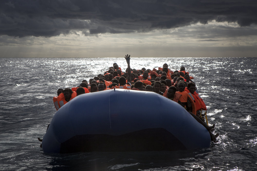 Rubber boat full of migrants after life jackets were distributed by the MOAS crew