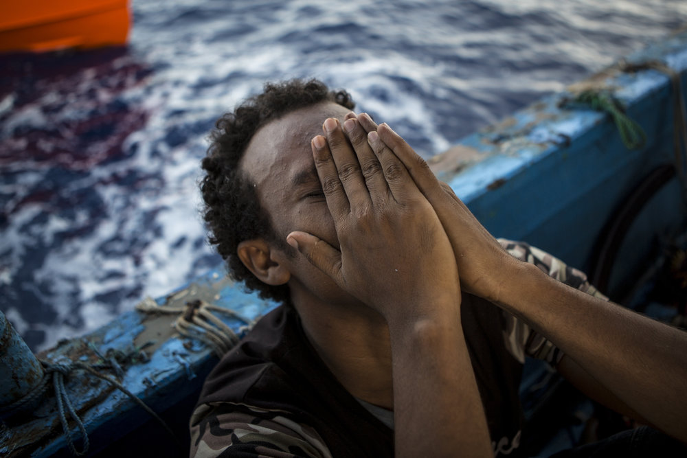 A migrant grieves over the death of his brother. 4 lifeless bodies were recovered by the migrants from separate holds. � Mathieu Willcocks/MOAS.eu 2016, all rights reserved.