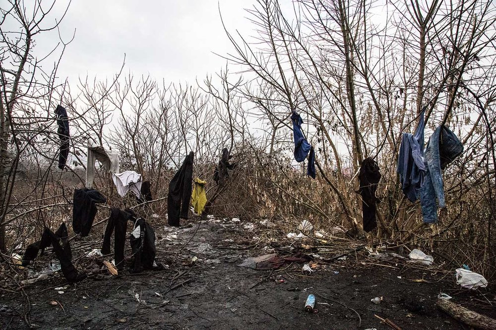 """Laundry hanged out to dry in the """"barracks"""" an abandoned industrial complex in the area of Belgrade's Central Station, where almost 1,300 refugees from Palistan and Afghanistan are currently sleeping rough."""
