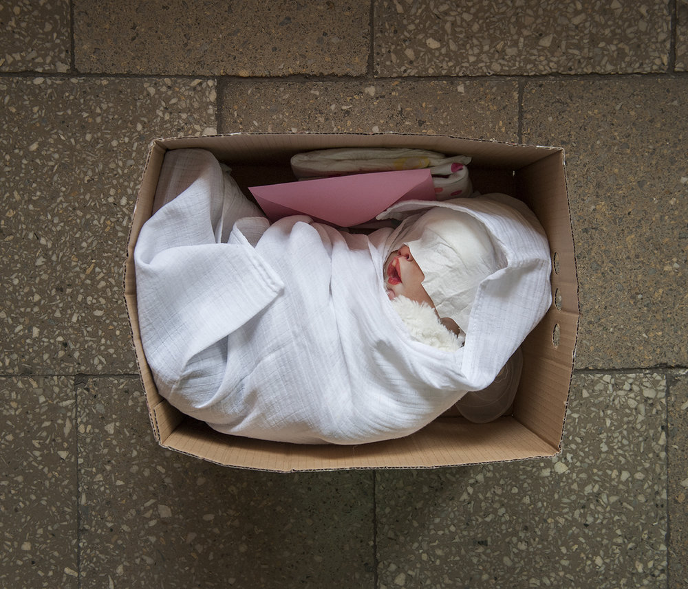 "The new reborn doll is packed and ready to be sent to a new ""mummy"". The package includes a birth certificate and layette. The box opening ritual is very important for new doll owners. Many women film this moment and share it on YouTube and reborn doll forums."
