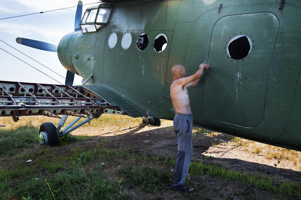 Moldova. Ceadir Lunga, Gagauzia - July 2017  Ceadir Lung Aerodrome which was closed 15 years ago following a plain crash. Nicolai, 67, has been working at th eaerodrome for the last 30 years as a guard.