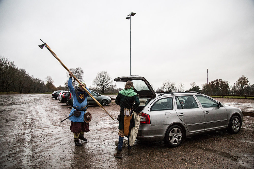 Ola and his son, both Viking reenactors, take their fighting gear out of their car, before a training session near Malmo, Southern Sweden.
