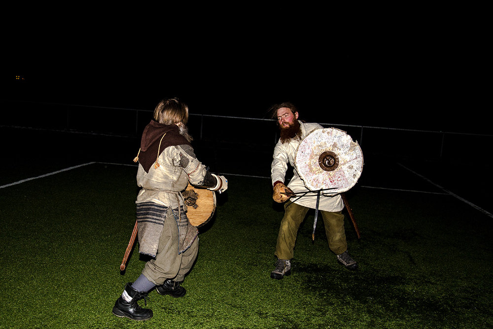 Two Viking fighters practice at night, during the historical fighting festival Vinter held every year in Norway.