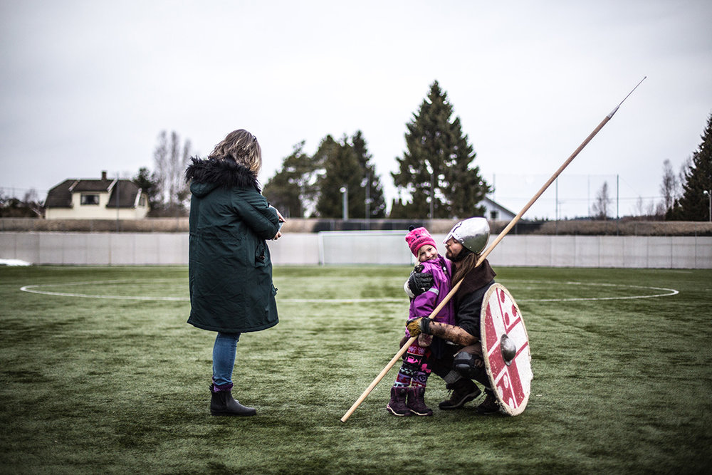 A Viking fighter and his family during the historical fighting festival Vinter, held every year in Norway.