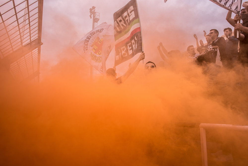 Smoke bombs during the game are also a way of showing off to the opponent group.
