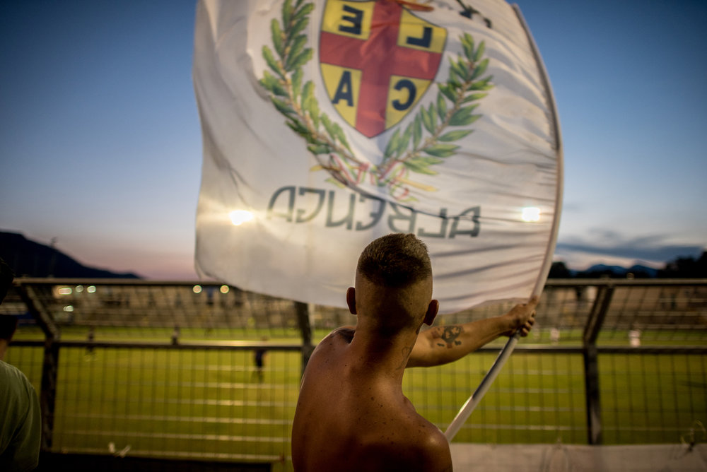 Pul waves the Albenga flag during a game.