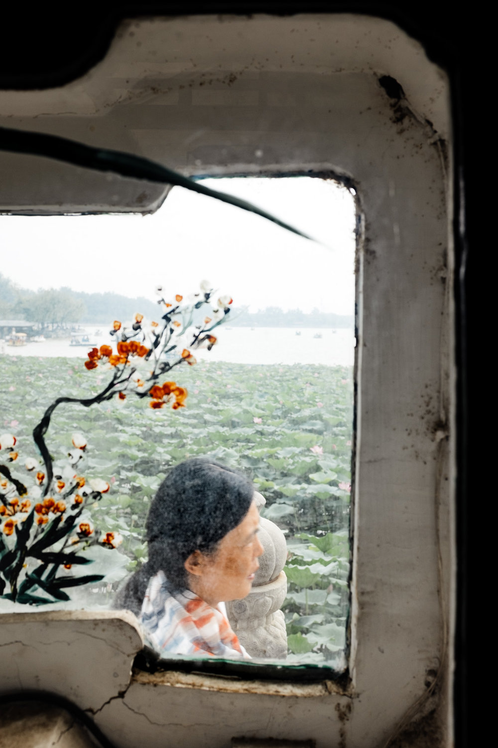 A woman through a window at the Summer Palace, Beijing, August 2017
