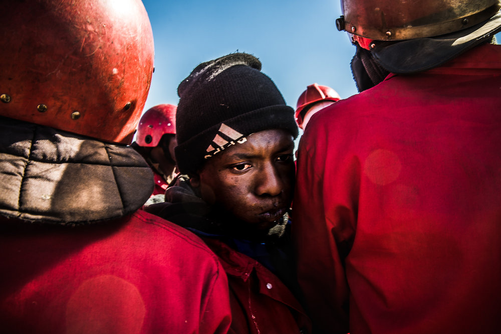 South Africa, Soshanguve, 11.09.2018 // Landgrabbs are occurring more often lately. In this instant, like in many others, the police refused to clear the settlement, so the Red Ants eviction-service was called in. Workers of the Red Ants security group found drinking water in a house they demolished. Instantly a wrangle for the drinking water occurred. // Lucas Bäuml
