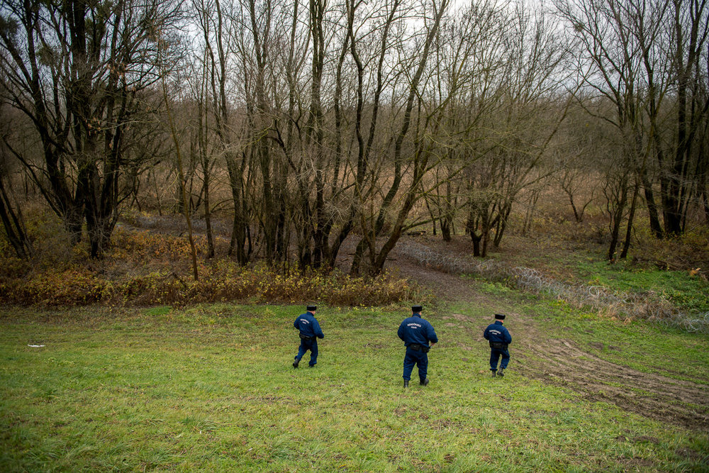 Policemen patroling near the barbed wire fence in the flood basin of Danube near Kölked, Hungary 9 December 2017. The fence was constructed in the middle of the European migration crisis in 2015, with the aim to ensure border security by preventing immigrants from entering the country and the European Union illegally.