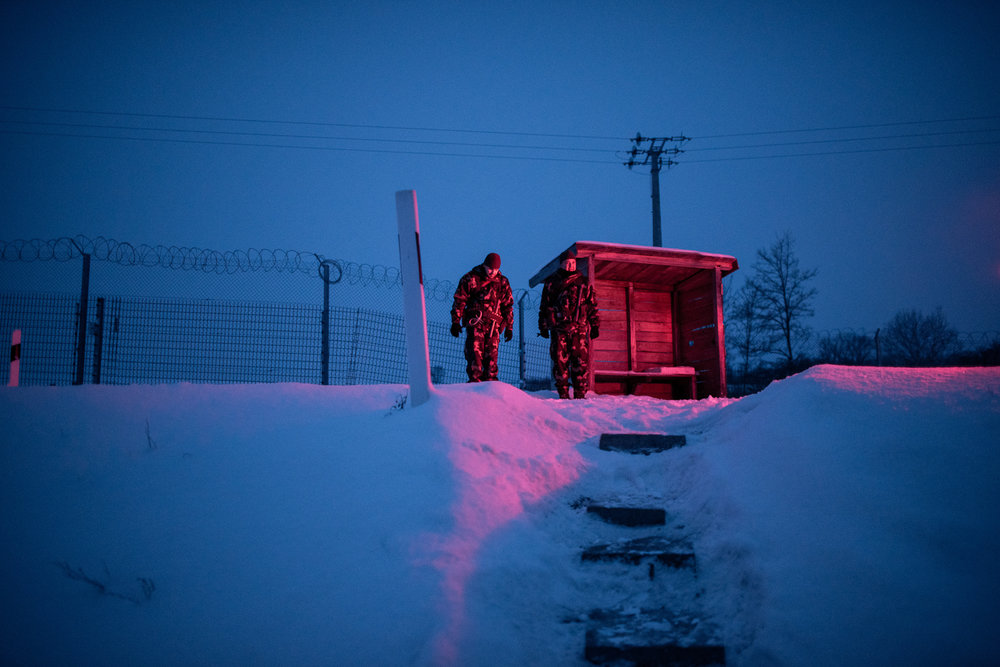 Soldiers stands in front of a military shelter to secure the border between Hungary and Serbia near Gara, Hungary 27 February 2018. The Hungarian border fence was constructed in the middle of the European migration crisis in 2015, with the aim to ensure border security by preventing immigrants from entering the country and the European Union illegally.