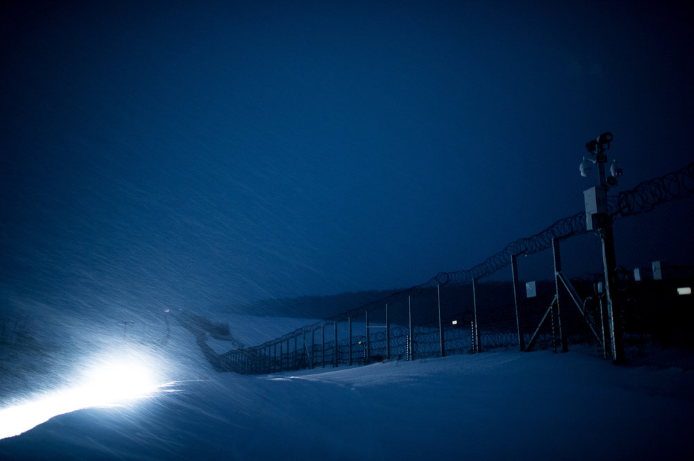 Military vehicle lights the snowfall between the two fences between Hungary and Serbia at Hercegszántó 27 February 2018. The fence was constructed in the middle of the European migration crisis in 2015, with the aim to ensure border security by preventing immigrants from entering the country and the European Union illegally.