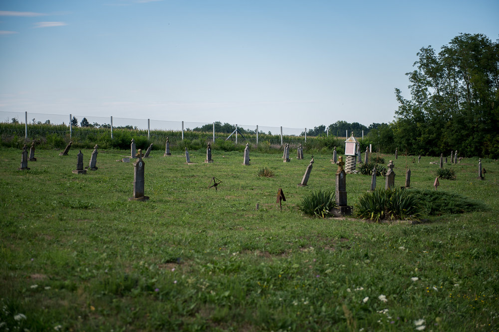 A cemetery in front of the Hungarian border barrier at the border between Hungary and Croatia at Luc, Croatia, 30 July 2017. The fence was constructed in the middle of the European migration crisis in 2015, with the aim to ensure border security by preventing immigrants from entering the country and the European Union illegaly.