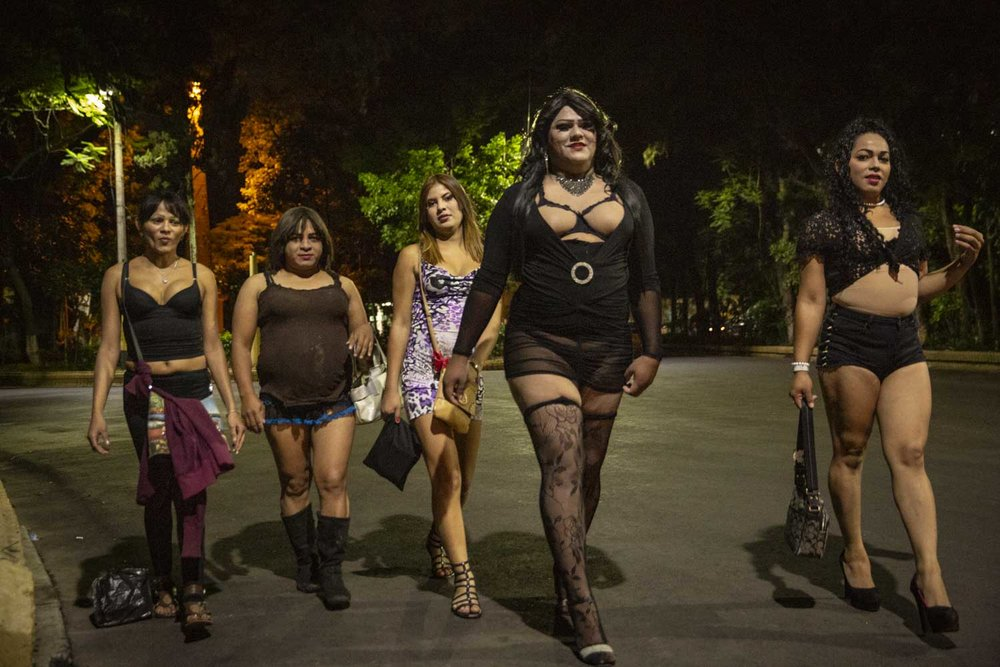 Ruby, JLO and other members of the LGBT orgnisation Arcoiris walk to their spot in Tegucigalpa they call El Obelisco, where they work during the night in prostitution. It is often  hard for LGBT people to find a job.